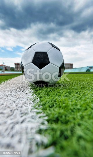 185262834 istock photo Soccer ball on white line 1095227274