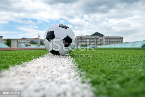 185262834 istock photo Soccer ball on white line 1095227296