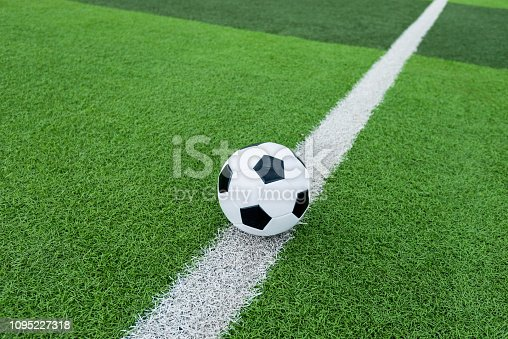 185262834 istock photo Soccer ball on white line 1095227318