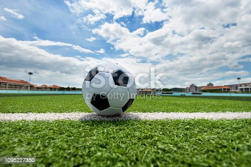 185262834 istock photo Soccer ball on white line 1095227350