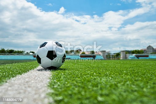 185262834 istock photo Soccer ball on white line 1183054779