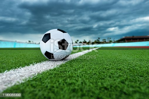 185262834 istock photo Soccer ball on white line 1183055300