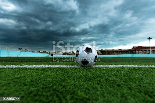 istock Soccer ball on white line 908560744
