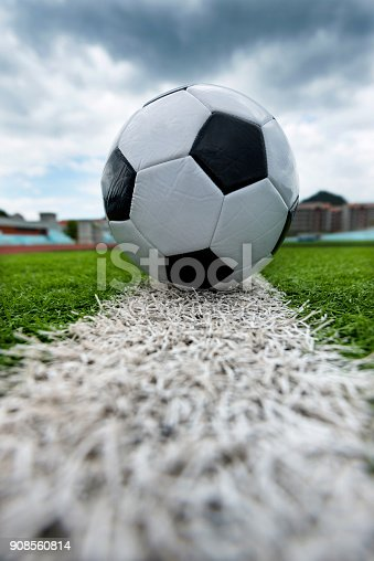 185262834 istock photo Soccer ball on white line 908560814