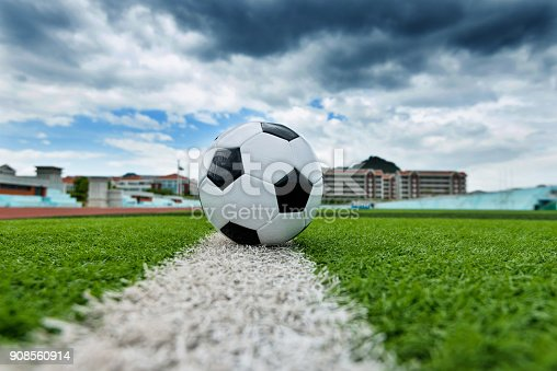 185262834 istock photo Soccer ball on white line 908560914