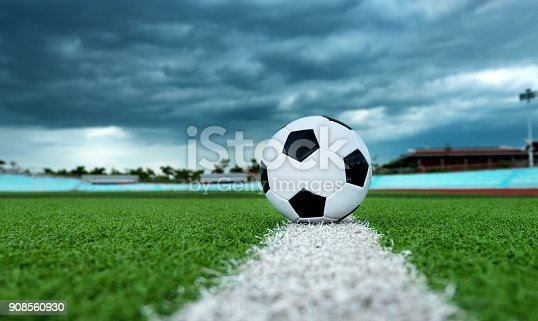 185262834 istock photo Soccer ball on white line 908560930
