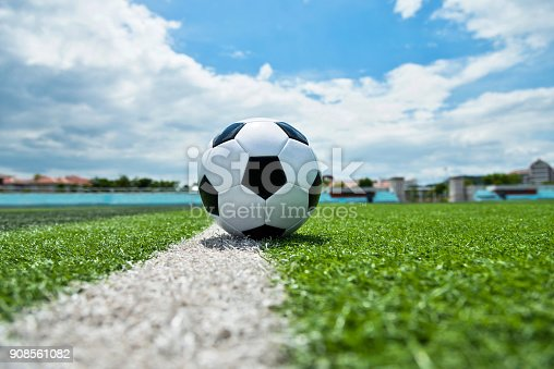 185262834 istock photo Soccer ball on white line 908561082