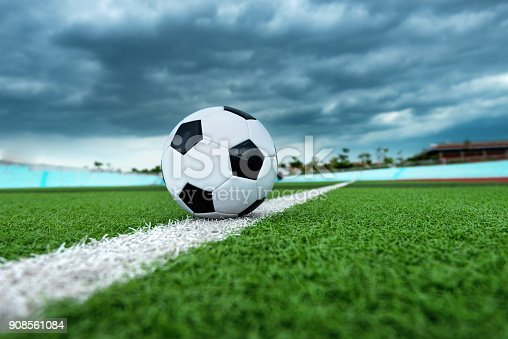 185262834 istock photo Soccer ball on white line 908561084