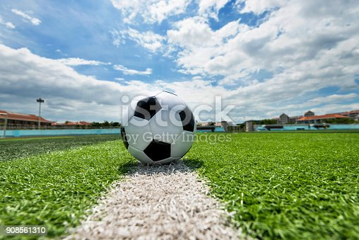 185262834 istock photo Soccer ball on white line 908561310