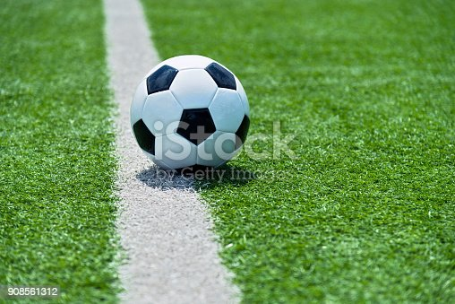 185262834 istock photo Soccer ball on white line 908561312