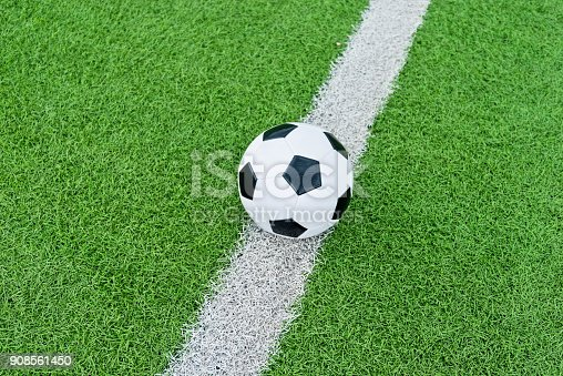 185262834 istock photo Soccer ball on white line 908561450