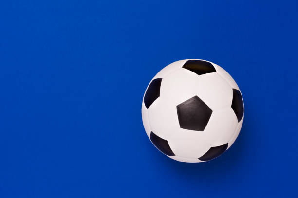 Soccer ball or football on blue background stock photo