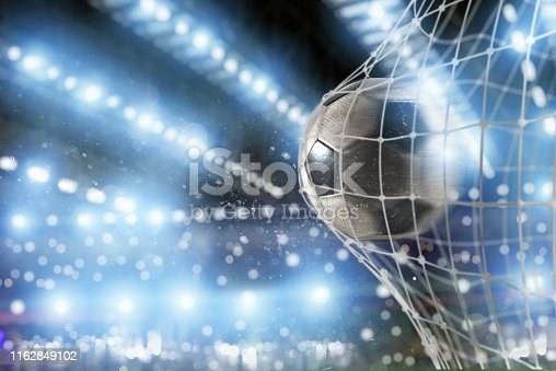 istock Soccer ball scores a goal on the net 1162849102