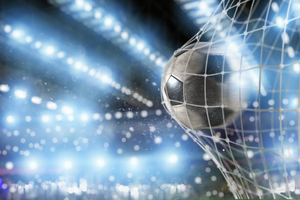 Soccer ball scores a goal on the net - foto stock