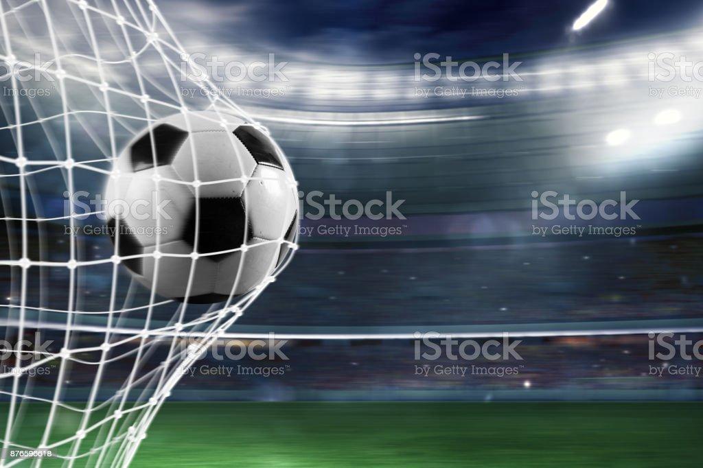 Soccer ball scores a goal on the net - Стоковые фото Атлет роялти-фри