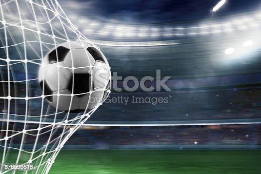 istock Soccer ball scores a goal on the net 876596618