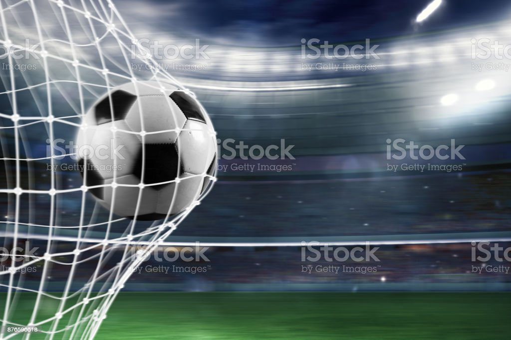 Soccer ball scores a goal on the net stock photo