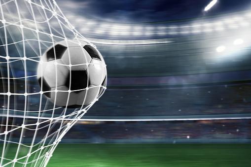 Soccer Ball Scores A Goal On The Net — стоковые фотографии и другие картинки Атлет