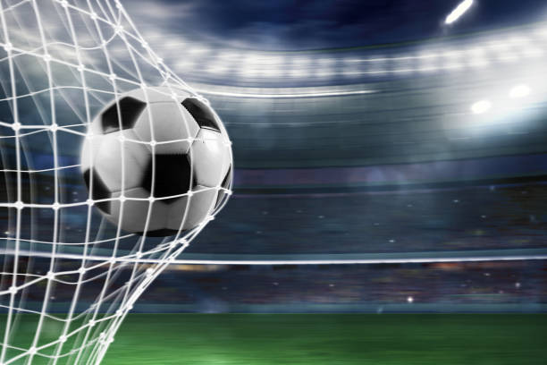 Soccer ball scores a goal on the net - foto stock