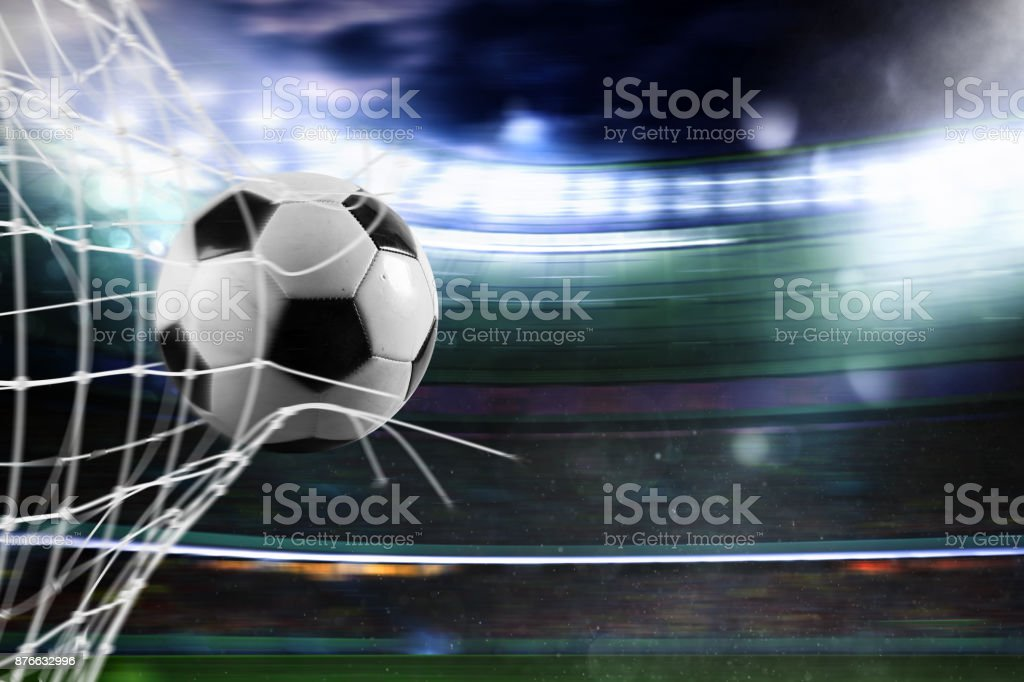 Soccer ball scores a goal on the net foto stock royalty-free