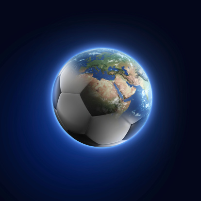 Soccer ball transforming into Earth on dark background