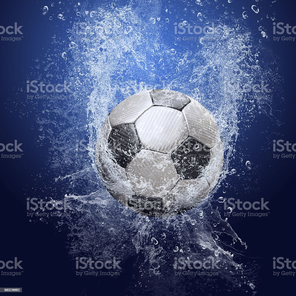 Soccer ball under water royalty-free stock photo