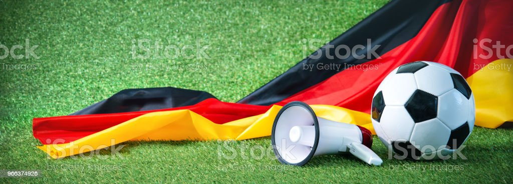 Soccer ball with german flag and megaphone royalty-free stock photo