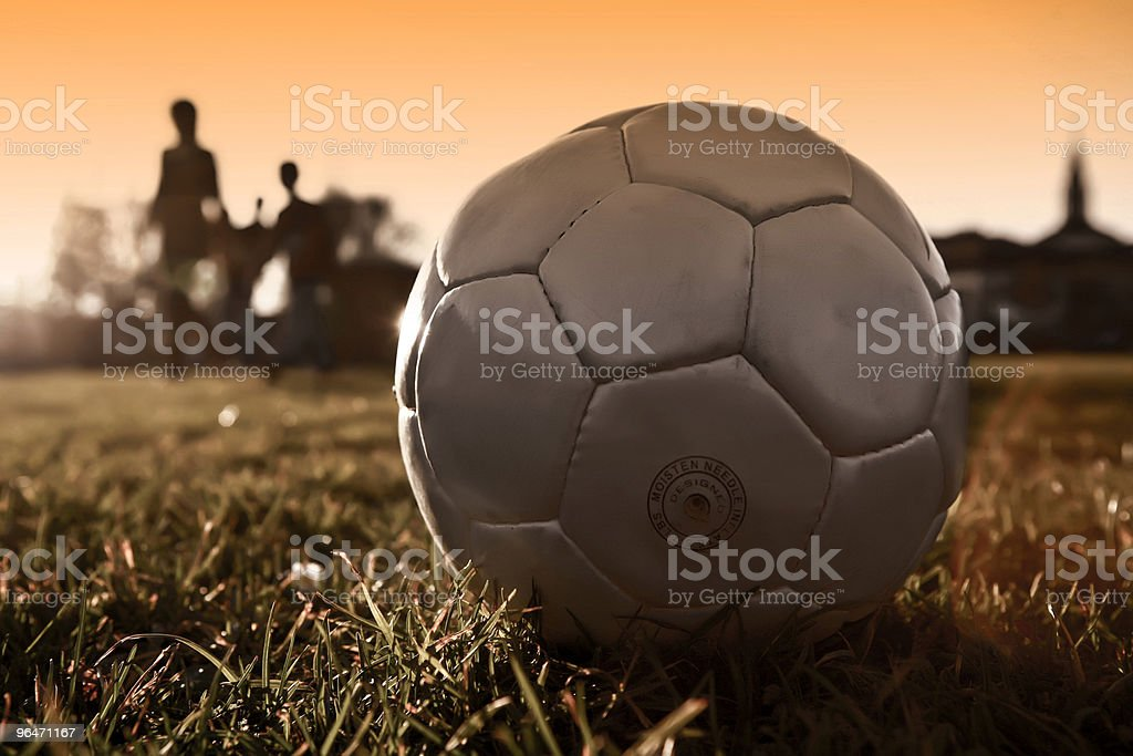 Soccer ball with people silhouette in silver version royalty-free stock photo