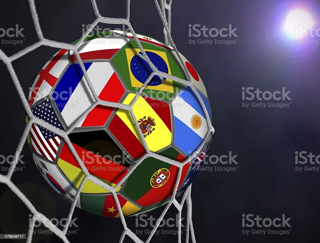Soccer Ball with Team Flags in Goals Net stock photo