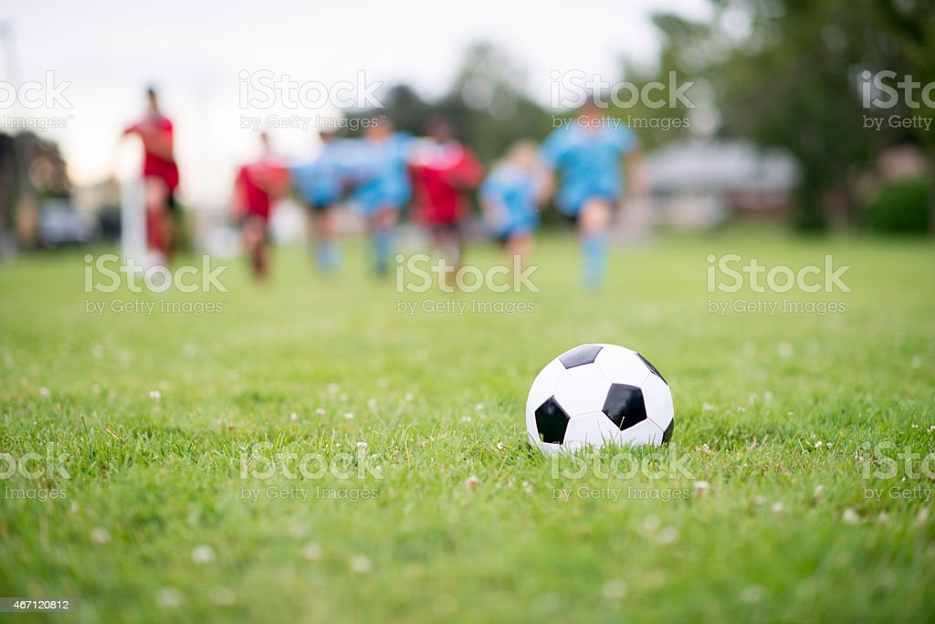 Soccer Ball with Team in Background stock photo