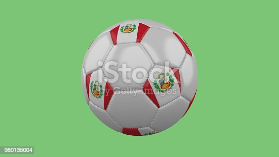 istock Soccer ball with the Peru flag isolate on a green background, 3D rendering 980135004