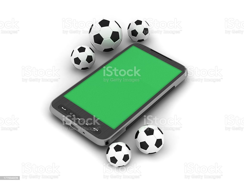 Soccer balls and mobile phone royalty-free stock photo