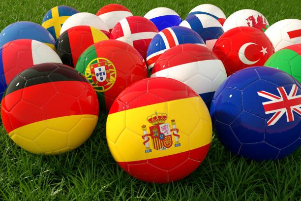 fotbollsbollar med flagga på gräsplan - football portugal flag bildbanksfoton och bilder
