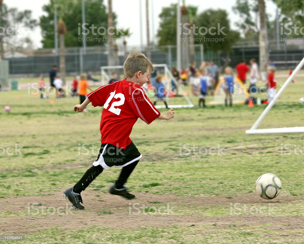 Soccer Boy in Motion to Make a Goal stock photo