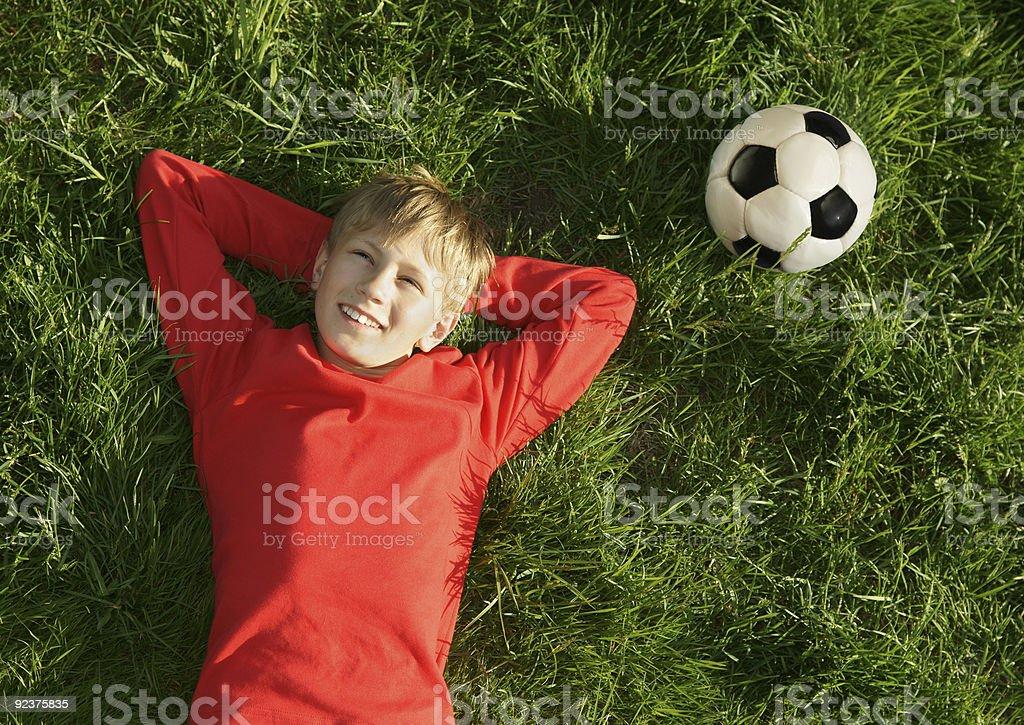 Soccer boy rest royalty-free stock photo