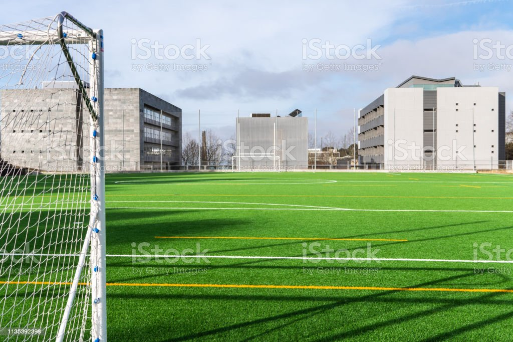 Soccer camp with modern buildings at background stock photo