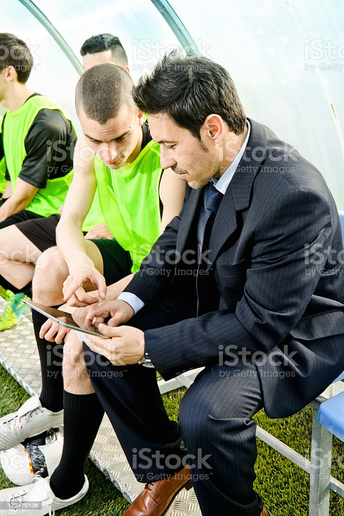 Soccer coach at work, using digital table, Ipad stock photo