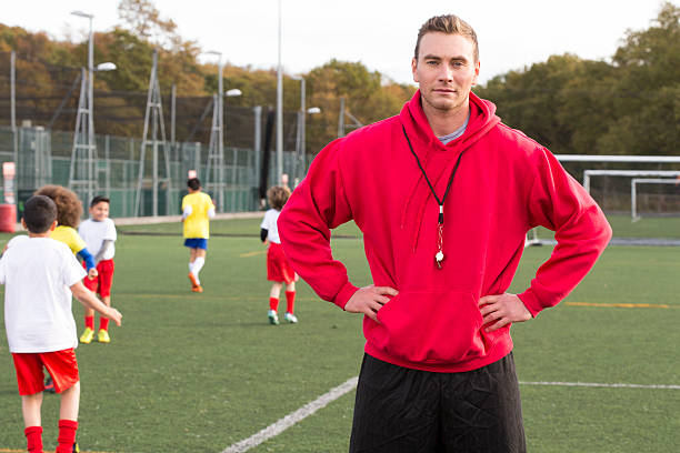 soccer coach on the pitch - coach stock photos and pictures