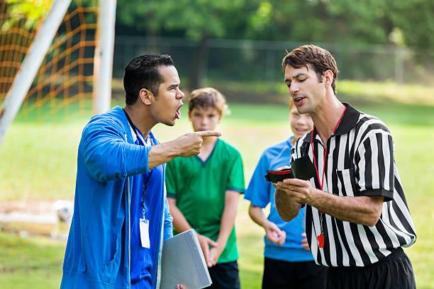 Soccer coach yells at referee over bad call - Photo