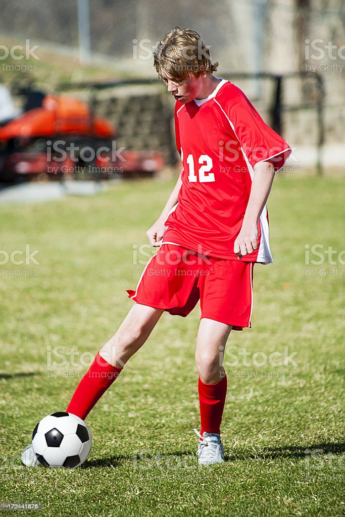 Soccer Controlled Touch on Ball Red Uniform royalty-free stock photo