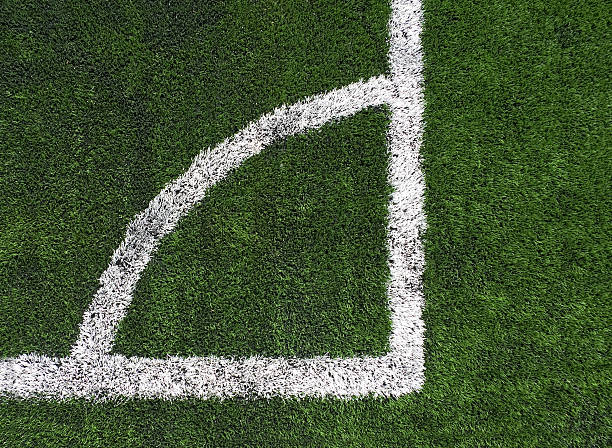 soccer corner kick marker Birdseye view of corner kick marker on soccer field with artificial turf. right angle stock pictures, royalty-free photos & images