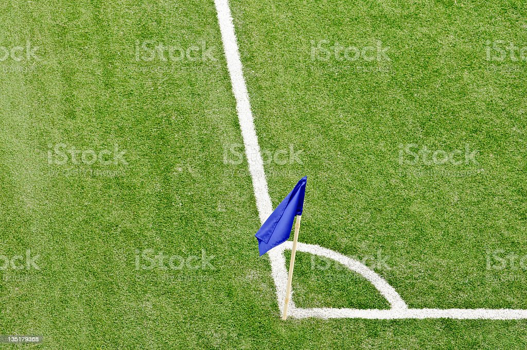 Soccer corner with blue flag royalty-free stock photo