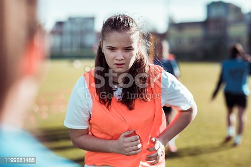 Close up of a young female soccer club doing soccer drills in the morning