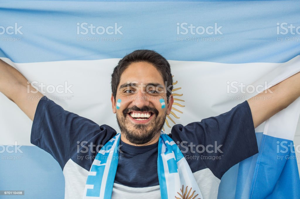 Soccer fan cheering for national team at the game stock photo