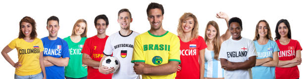 Soccer fan from Brazil with supporters from other countries stock photo