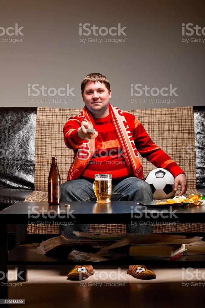 soccer fan on sofa stock photo