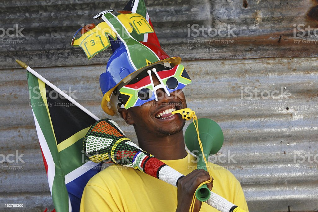 Soccer fan with Vuvuzela and Makaraba stock photo
