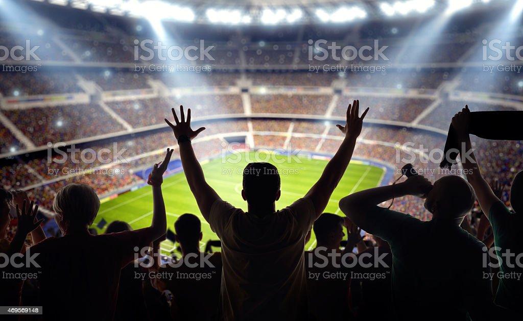 Los fanáticos del fútbol en el estadio - foto de stock
