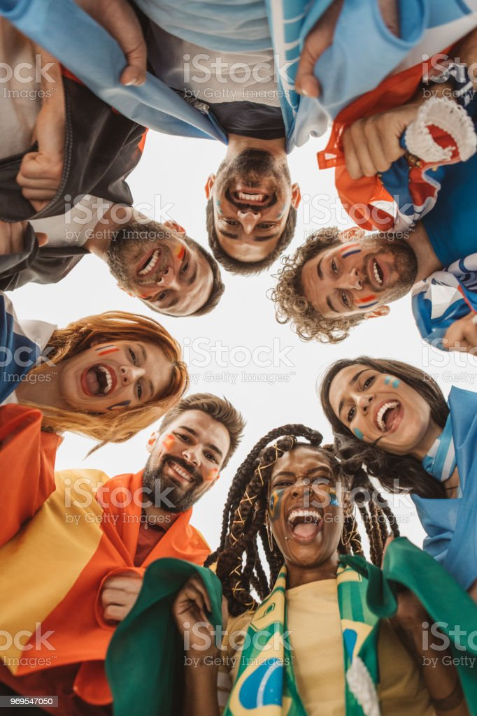 Soccer fans cheering for national teams stock photo