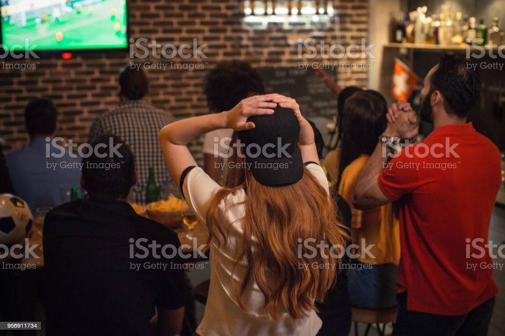 Soccer fans cheering stock photo
